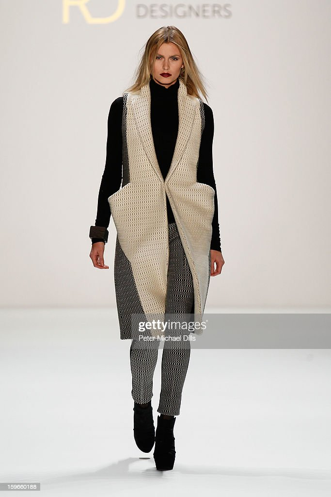 A model walks down the runway at Irina Schrotter Autumn/Winter 2013/14 fashion show during Mercedes-Benz Fashion Week Berlin at Brandenburg Gate on January 18, 2013 in Berlin, Germany.