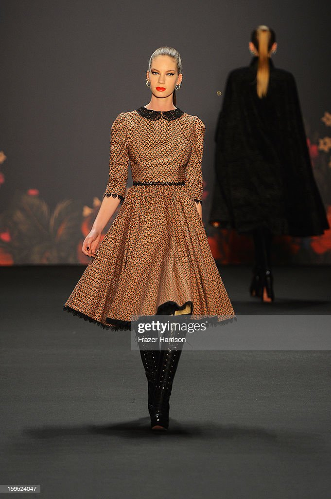 A model walks down the runway at Lena Hoschek Autumn/Winter 2013/14 fashion show during Mercedes-Benz Fashion Week Berlin at Brandenburg Gate on January 15, 2013 in Berlin, Germany.