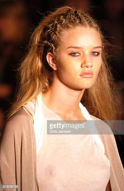 Model walks down the runway at the John Rocha fashion show as part of London Fashion Week Spring/Summer 2005 at Claridge's on September 20 2004 in...