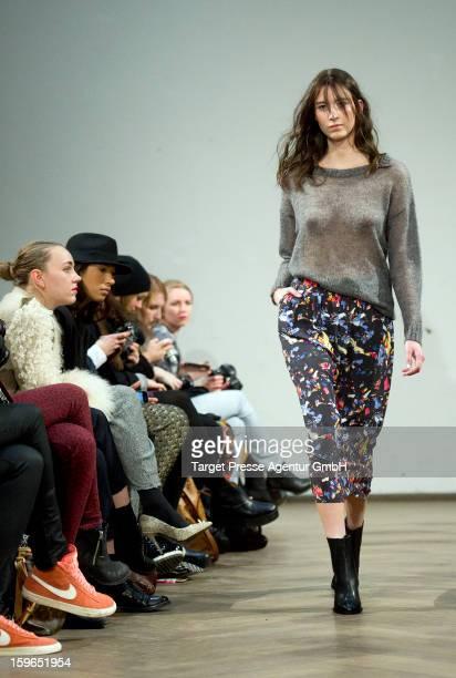 A model walks down the runway at the 'Malaikaraiss' fashion show at Villa Elisabeth during MercedesBenz Fashion Week Autumn/Winter 2013/14 on January...