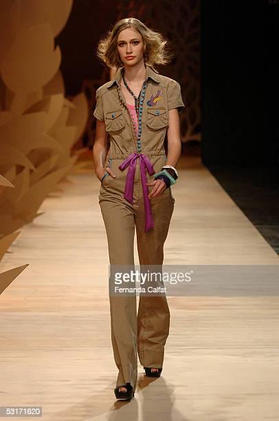 A model walks down the runway at the Triton Summer 2006 fashion presentation during Sao Paulo Fashion Week June 29 2005 in Sao Paulo Brazil