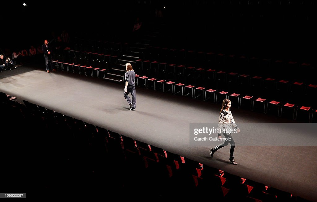 A model walks down the runway during rehearsal ahead of the Michael Sontag Autumn/Winter 2013/14 fashion show during Mercedes-Benz Fashion Week Berlin at Brandenburg Gate on January 17, 2013 in Berlin, Germany.