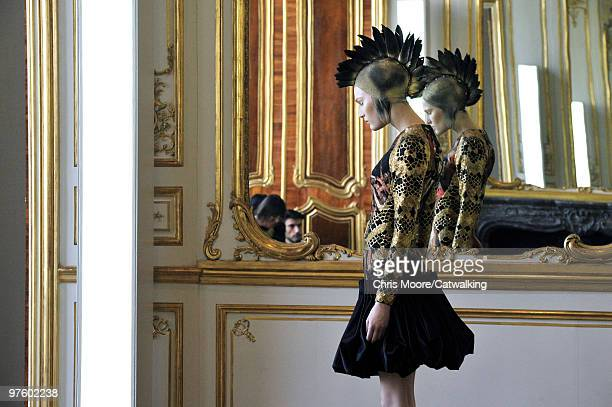 A model walks down the runway during the Alexander McQueen fashion presentation part of Paris Fashion Week Paris on March 9 2010 in Paris France