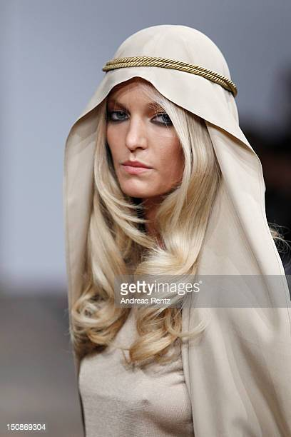 A model walks down the runway during the Busnel S/S 2013 Fashion Show at the MercedesBenz Stockholm Fashion Week on August 28 2012 in Stockholm Sweden