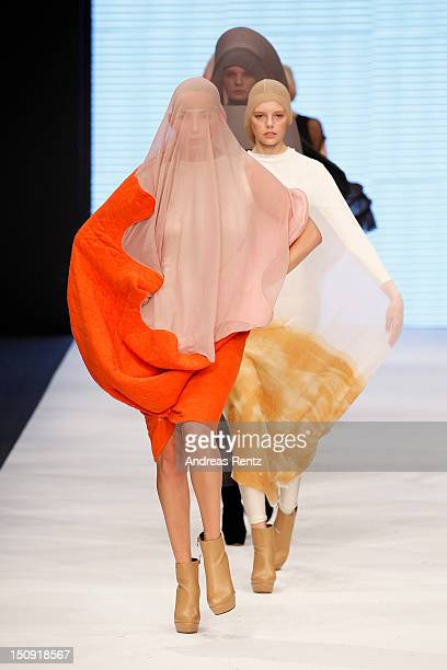 A model walks down the runway during the Linnea Bagander S/S 2013 Fashion Show from the Swedish School of Textiles during the MercedesBenz Stockholm...