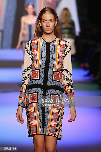 A model walks down the runway during the MSGM Di Massimo Giorgetti Show during the first day of the MercedesBenz Fashion Days at Schiffbau on...