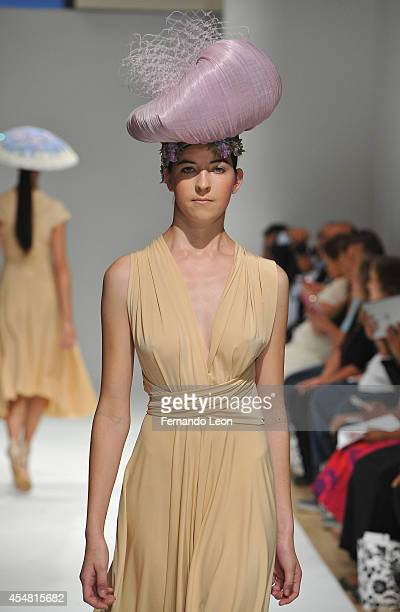 A model walks down the runway while wearing designer Louis Quinones designs during the Designers' Review fashion show at Helen Mills Event Space on...