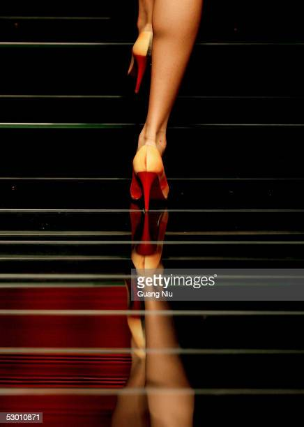 A model walks down the stage during a fashion show by Italian designers at Chaoyang Park on June 2 2005 in Beijing China The event is held by Italian...