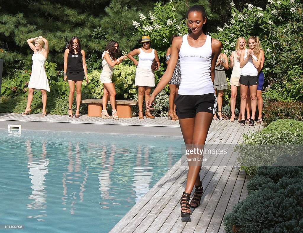 the hamptons fitness wellness poolside soiree photos and images a model walks during the hamptons fitness wellness poolside soiree at a private residence on