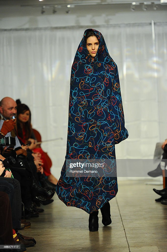 A model walks during the Mischka Velasco presentation during Mercedes-Benz Fashion Week Fall 2014 at Top of the Garden on February 10, 2014 in New York City.