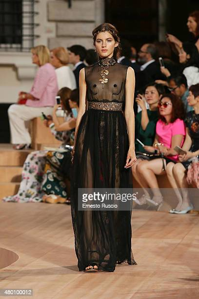 Model walks during the Valentino Mirabilia Romae Fashion show at Piazza Mignanelli on July 9 2015 in Rome Italy