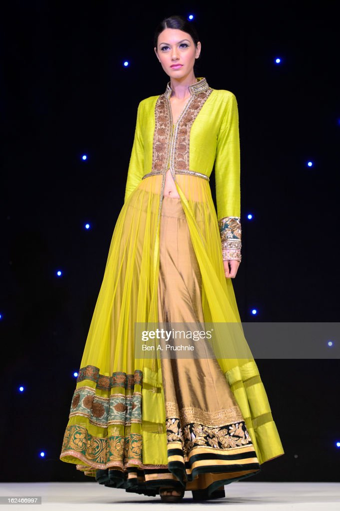 A model walks in a catwalk show at a charity fundraising event hosted by Manish Malhotra in aid of 'Save the Girl Child' at The Grosvenor House Hotel on February 23, 2013 in London, England.