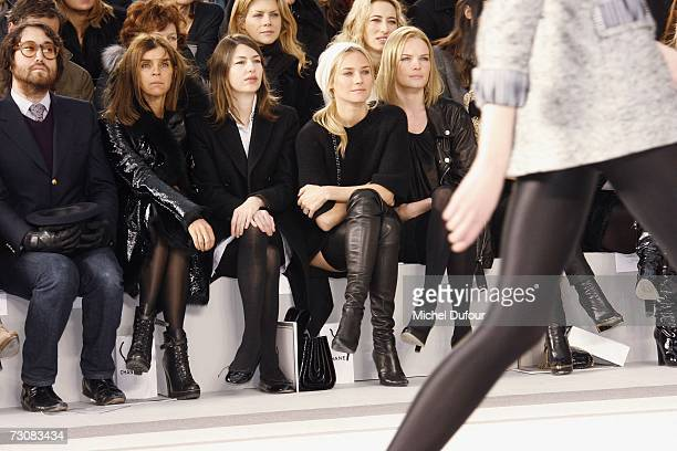 A model walks on the catwalk next to Sean Lennon Karine Rotfeld Sofia Coppola Diane Kruger and Kate Bosworth at the Chanel Fashion show during Paris...