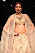 Model walks on the ramp for Fashion designer Varun Bahl with Jewelry Designer Sumit Sawhney Show at the 'Jazbaa' event conceptualized by FDCI and...