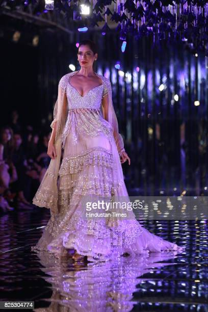 A model walks on the ramp showing creations made by designer Manish Malhotra during the India Couture Week 2017 on July 30 2017 in New Delhi India