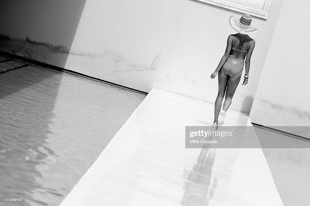 A model walks on the runway at the BCBGeneration show during Mercedes-Benz Fashion Week Swim 2014 at the SLS Hotel on July 21, 2013 in Miami Beach, Florida.