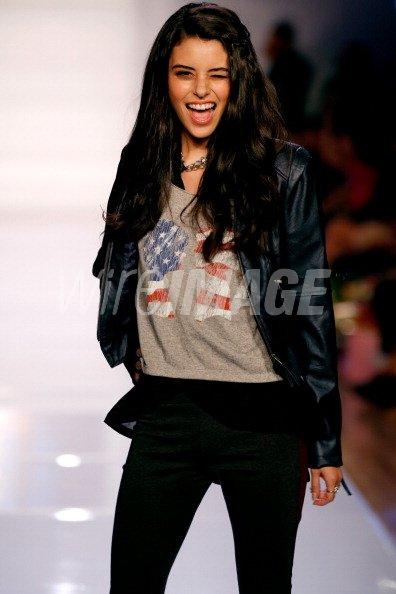 model walks on the runway...