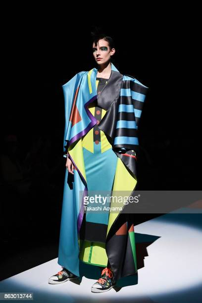A model walks on the runway during the Hiroko Koshino show as part of Amazon Fashion Week Tokyo 2018 S/S at the Garden Hall of the Yebisu Garden...