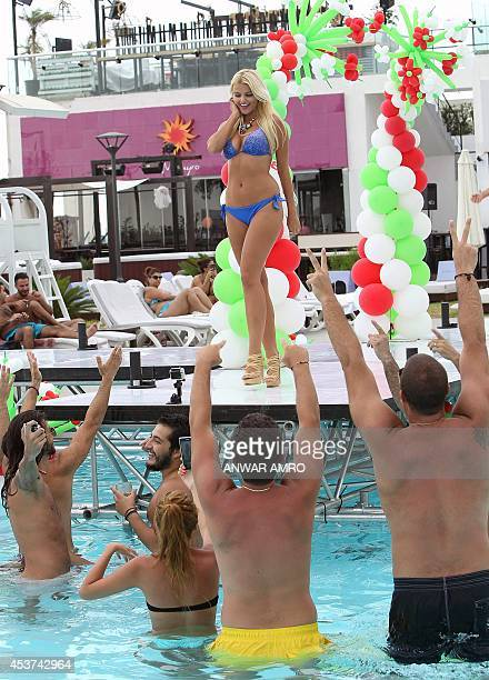 A model walks on the runway during the 'Miss Bikini' event part of 'World Next Top Model 2014' at the Publicity beach resort in the Lebanese coastal...