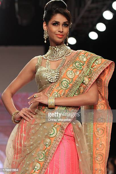 A model walks on the runway during the Saboo show on day 2 of India International Jewellery Week 2013 at the Hotel Grand Hyatt on August 5 2013 in...