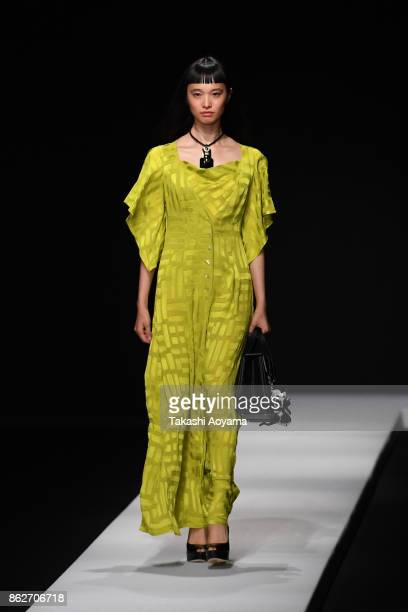 A model walks on the runway during the TAE ASHIDA show as part of Amazon Fashion Week Tokyo 2018 S/S at Grand Hyatt Tokyo on October 18 2017 in Tokyo...