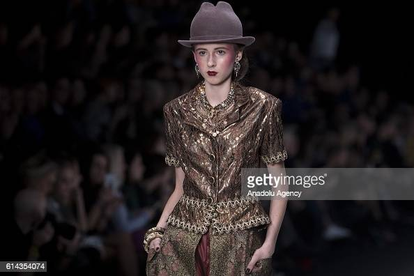 A model walks on the stage as she presents the designer Slava Zaitsev's collection during the MercedesBenz Fashion Russia in Moscow Russia on October...