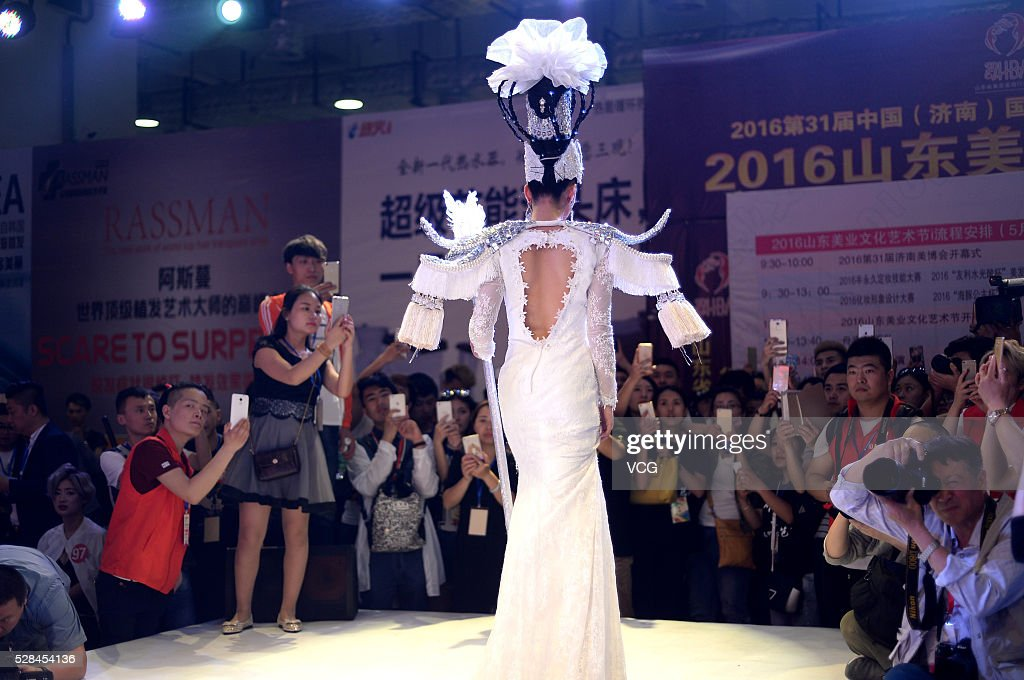 A model walks runway during the 31th China (Jinan) International Beauty, Hairdressing & Cosmetics Expo on May 5, 2016 in Jinan, Shandong Province of China. Participants showed various makeups and attire on the exposition.