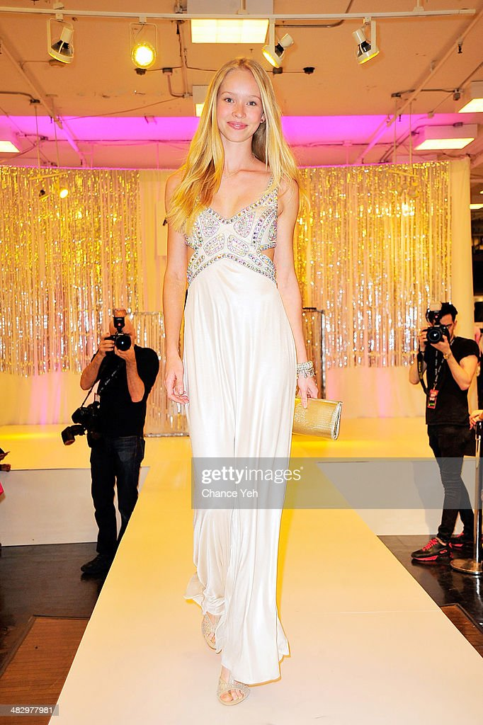 A Model walks runway in prom wear during Mack Wilds visit at Macy's Herald Square on April 5, 2014 in New York City.