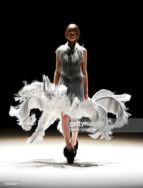 A model walks the catwalk at the Iris van Herpen Show during MercedesBenz Fashion Week Berlin Spring/Summer 2012 at the Brandenburg Gate on July 8...