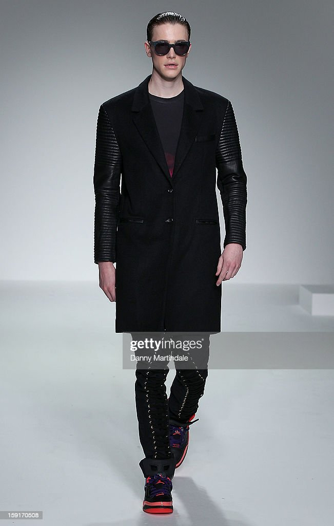 A model walks the catwalk at the Katie Eary show at the London Collections: MEN AW13 at The Hospital Club on January 9, 2013 in London, England.