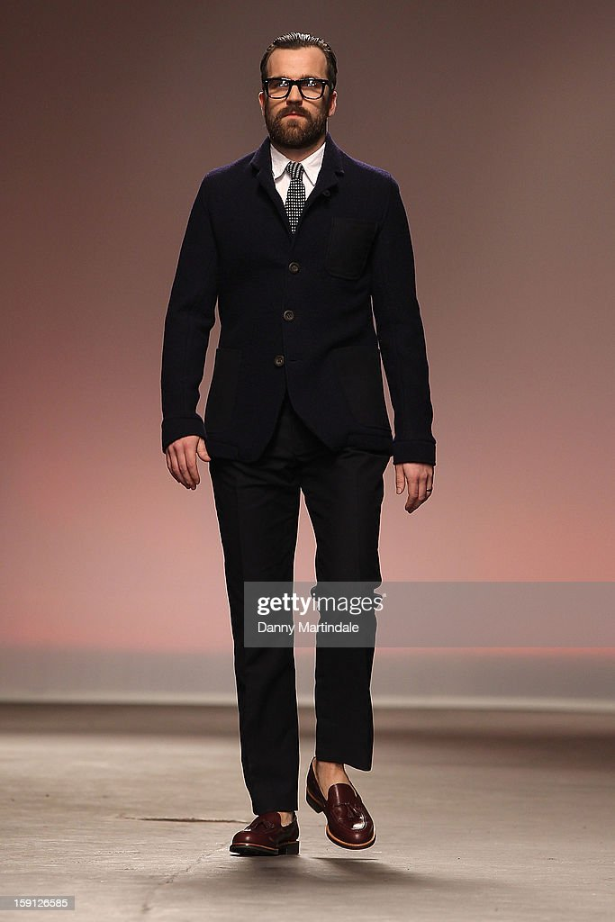 A model walks the catwalk at the Oliver Spencer show at the London Collections: MEN AW13 at The Old Sorting Office on January 8, 2013 in London, England.