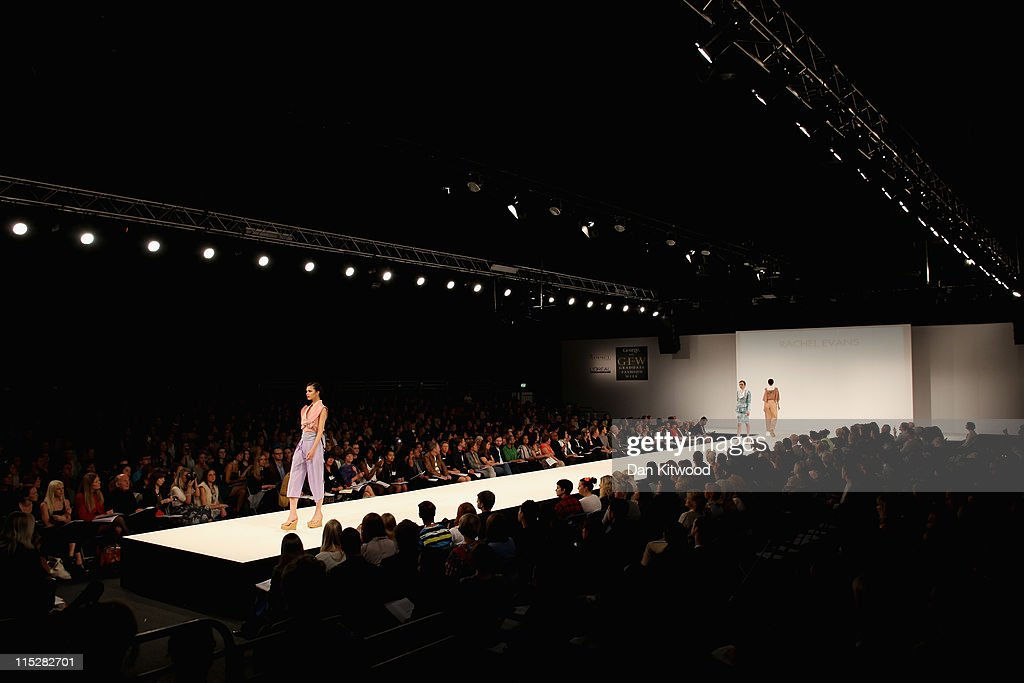 A model walks the catwalk during Graduate Fashion Week at Earls Court on June 6, 2011 in London, England. The event which began in 1991 showcases emerging talent from BA Graduate fashion design courses across the UK and includes exhibition stands and catwalk shows from around 50 universities.