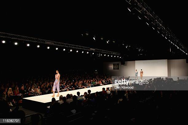 A model walks the catwalk during Graduate Fashion Week at Earls Court on June 6 2011 in London England The event which began in 1991 showcases...