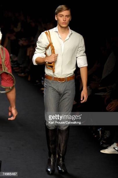 A model walks the catwalk during the Emanuel Ungaro fashion show as part of Spring Summer 2008 Paris Menswear fashion week on June 29 2007 in Paris...