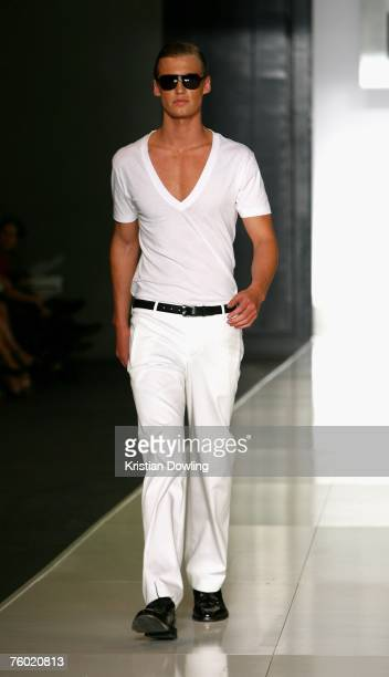A model walks the catwalk during the Hugo Boss collection show as part of the Myer Spring/Summer Collection Launch at the Carriageworks on August 8...