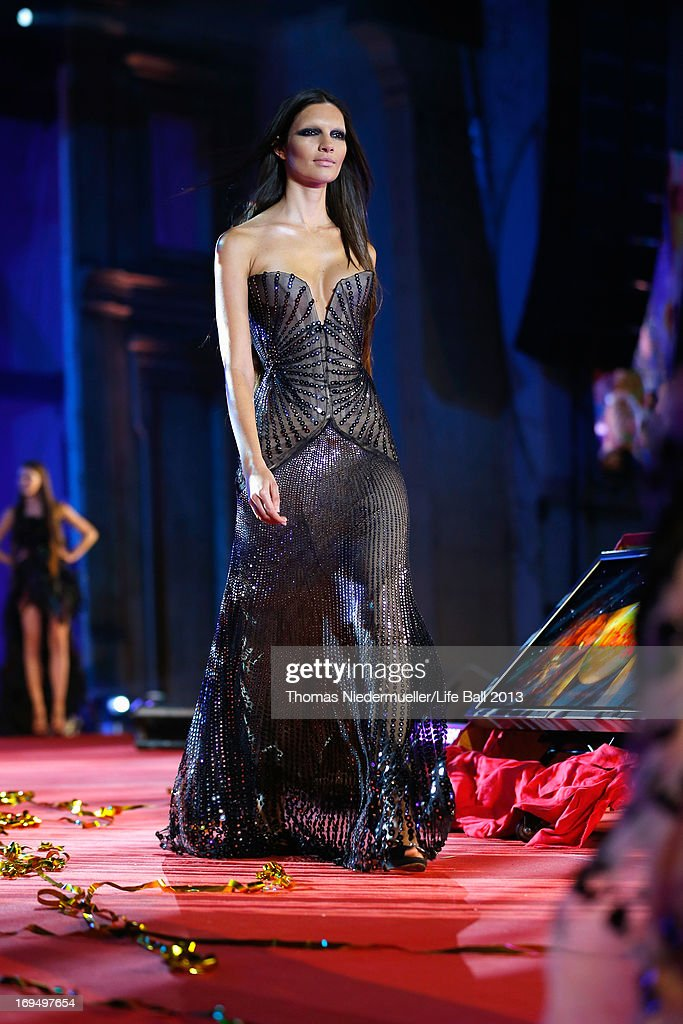 A model walks the catwalk during the 'Life Ball 2013 - Show' at City Hall on May 25, 2013 in Vienna, Austria.