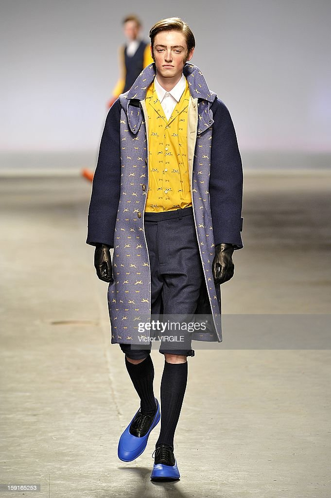 A model walks the catwalk during the MAN - Agi & Sam Ready to wear Fall/Winter 2013-2014 show at the London Collections: MEN AW13 at The Old Sorting Office on January 7, 2013 in London, England.