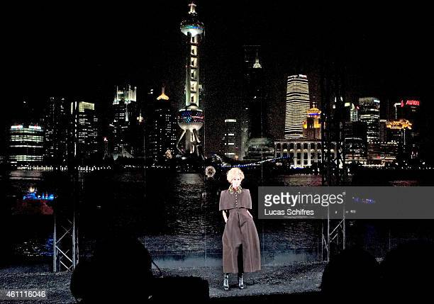 Model walks the catwalk in front of the famous Shanghai Pudong panorama at Chanel Fashion Show on December 3 2009 in Shanghai China