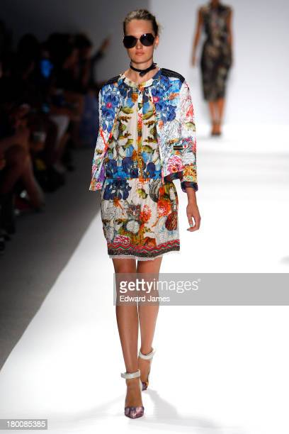 A model walks the Custo Barcelona runway during Spring 2014 MercedesBenz Fashion Week at The Stage at Lincoln Center on September 8 2013 in New York...