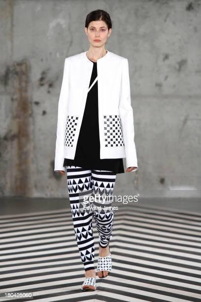 A model walks the Edun runway during Spring 2014 MercedesBenz Fashion Week at Skylight Modern on September 8 2013 in New York City
