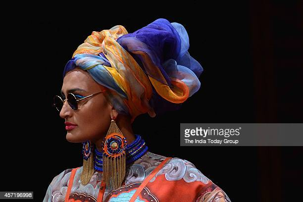 A model walks the ramp for designer Tarun Tahilian at Wills Fashion Week 2014 in New Delhi