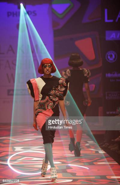 A model walks the ramp in a creation by Fashion Designer Manish Arora at Lakme Fashion Week Winter/Festive 2010