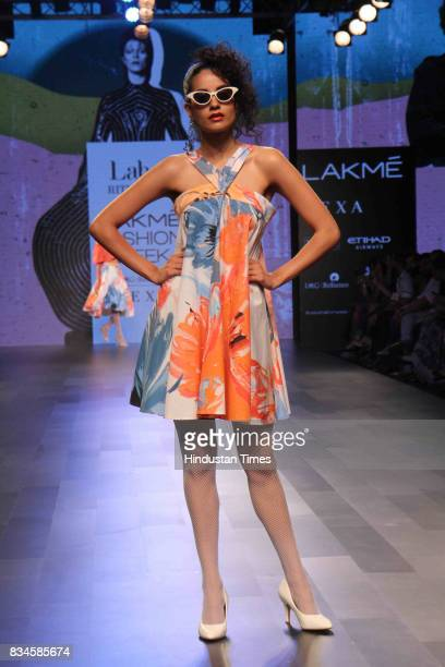 A model walks on the ramp showcasing the creations of designer Ritu Kumar during the Lakme Fashion Week 2017 on August 16 2017 in Mumbai India