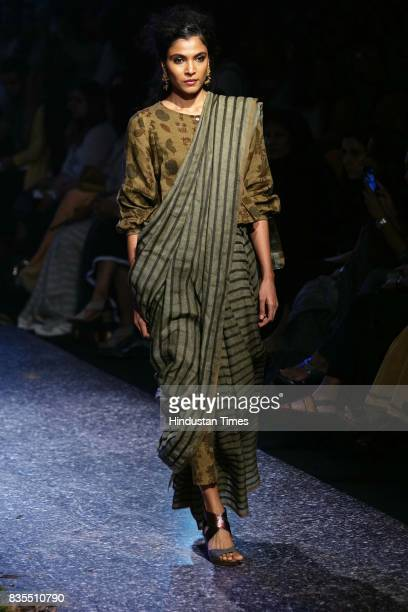 A model walks the ramp showcases the collection of designer Anavila Mishra during the Lakme Fashion Week 2017 at Royal Opera House on August 17 2017...
