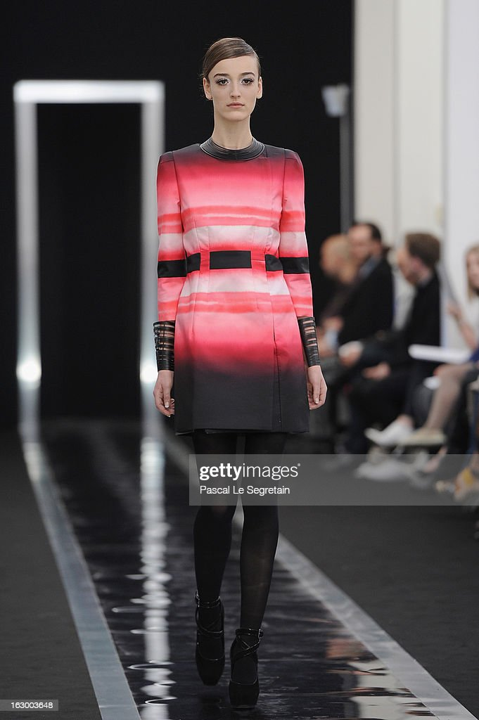 A model walks the run way during the Maxime Simoens Fall/Winter 2013 Ready-to-Wear show as part of Paris Fashion Week on March 3, 2013 in Paris, France.