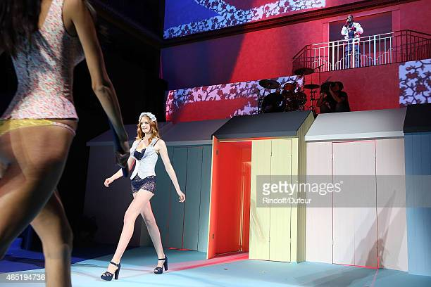 A model walks the runway as Snoop Dogg performs during the ETAM show as part of the Paris Fashion Week Womenswear Fall/Winter 2015/2016 at Piscine...