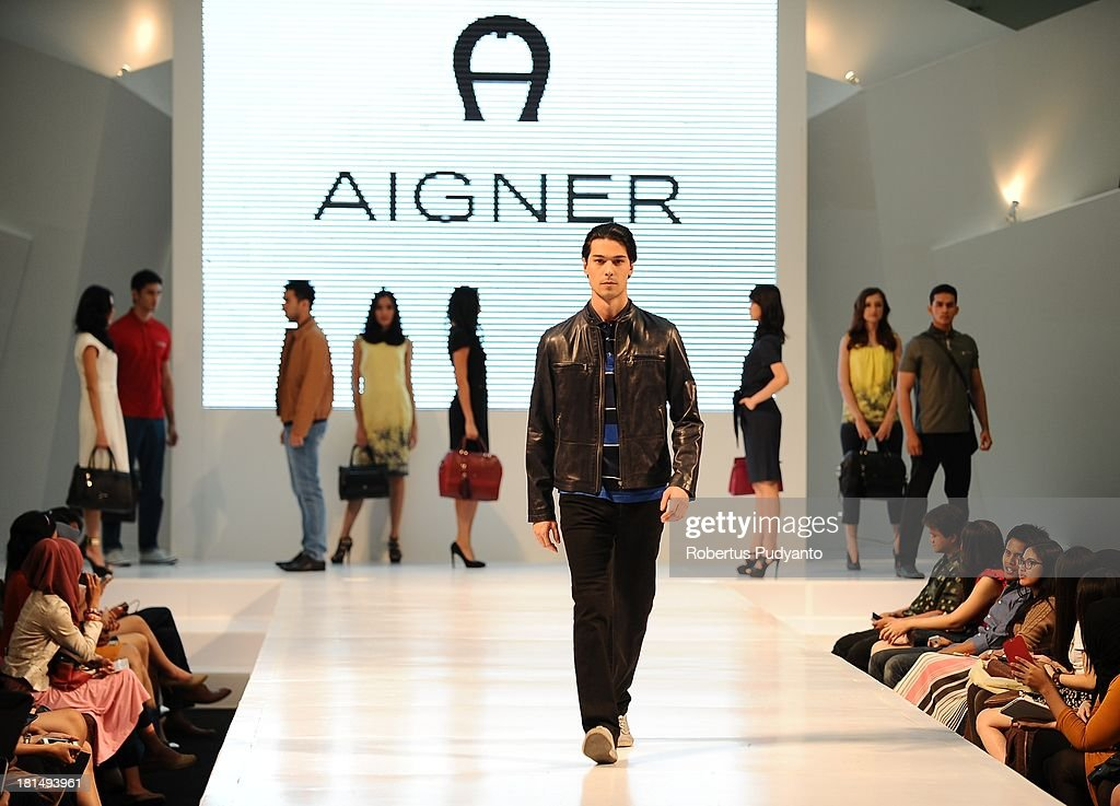 A model walks the runway at Aigner Autumn Winter Leather Collection show during Ciputra World Fashion Week 2013 on September 21, 2013 in Surabaya, Indonesia.