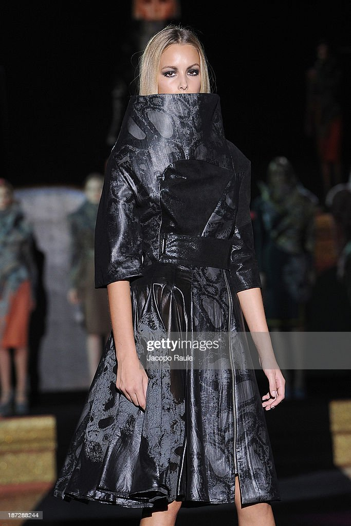 A model walks the runway at Alla Kuzmyk Fashion Show during the Mittelmoda Special Edition 2013 for Lectra on November 7, 2013 in Milan, Italy.
