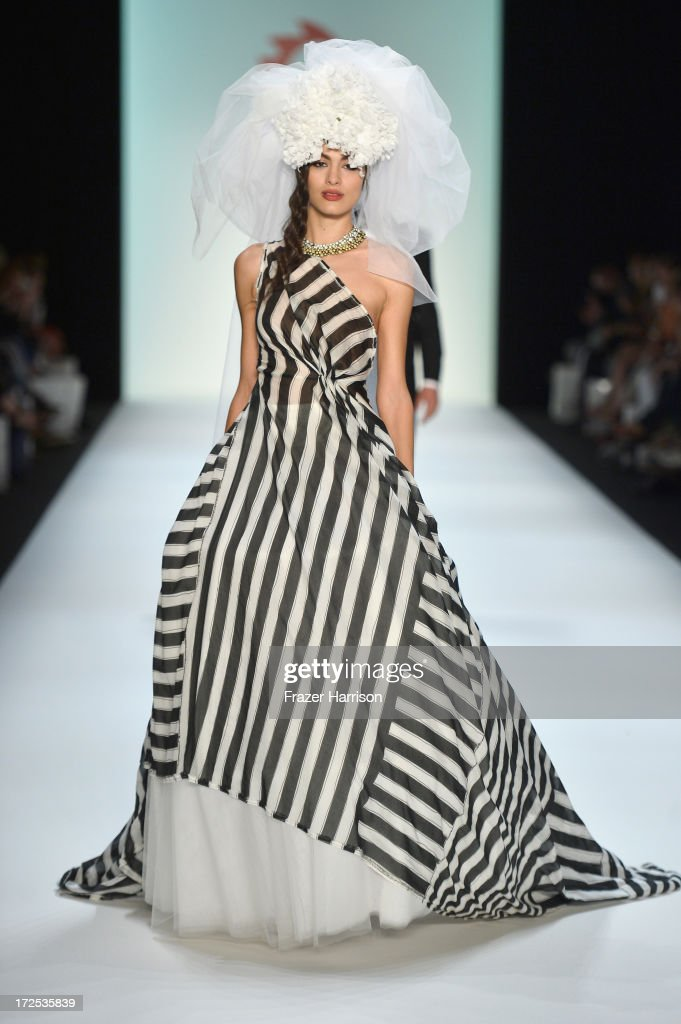 A model walks the runway at Anja Gockel show during Mercedes-Benz Fashion Week Spring/Summer 2014 at Brandenburg Gate on July 3, 2013 in Berlin, Germany.