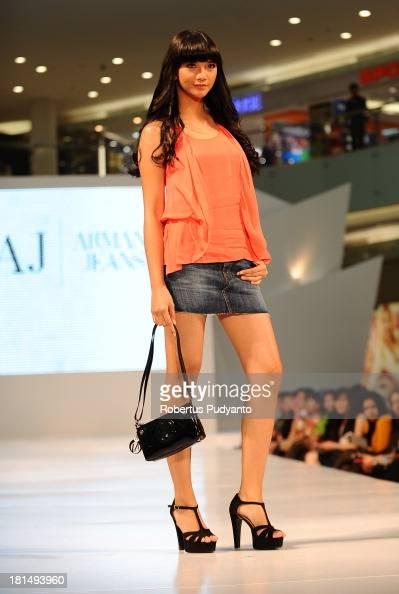A model walks the runway at Armani Jeans fashion show during Ciputra World Fashion Week on September 21 2013 in Surabaya Indonesia